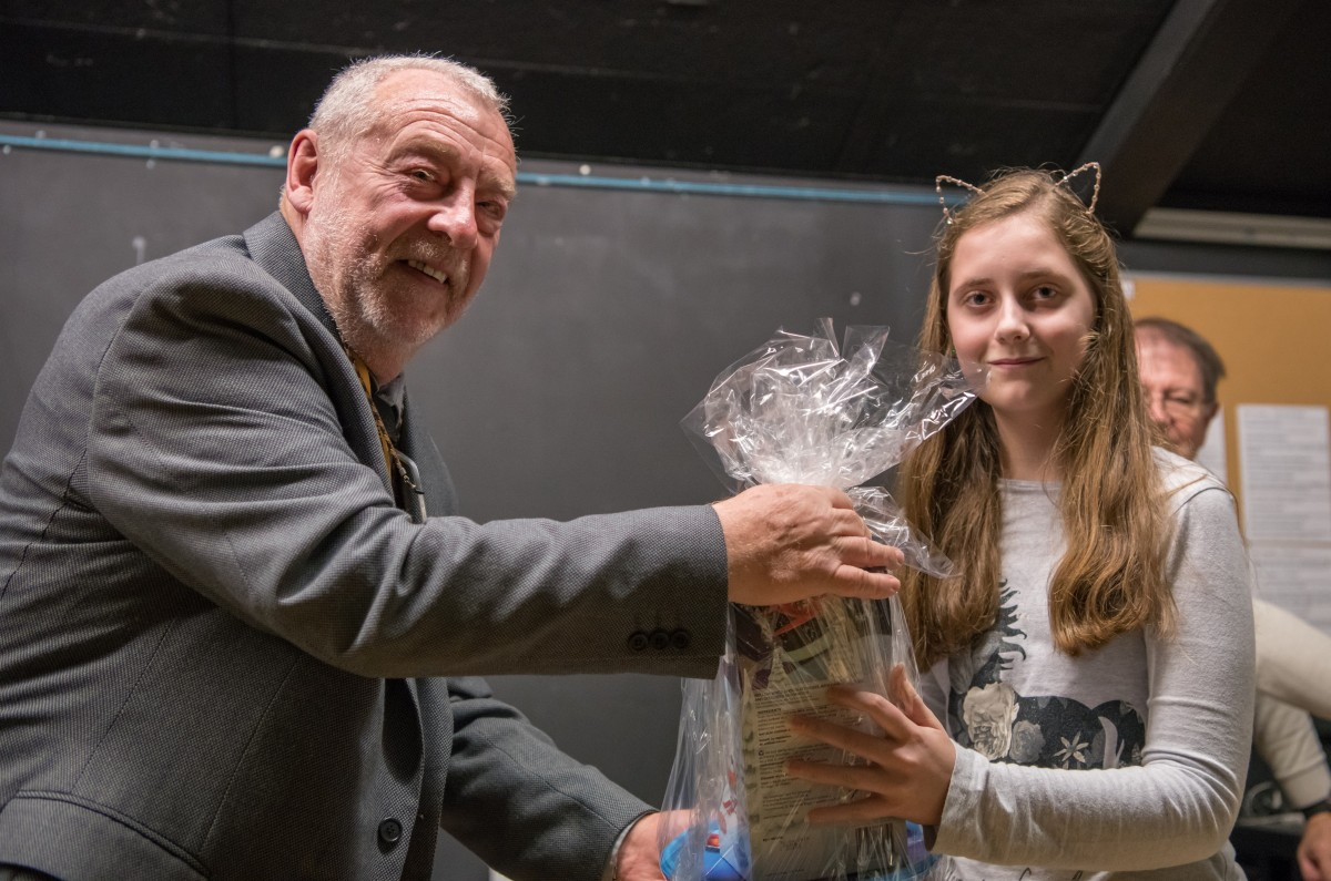 Paul Rutherford presents Megan Woodford with her prize