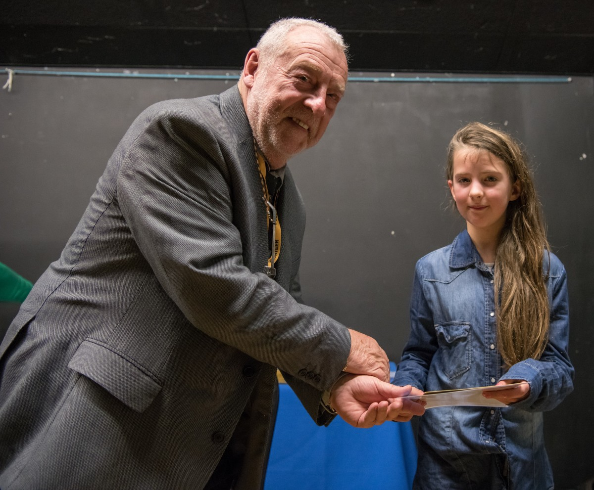 Paul Rutherford presents Kyra James with her prize