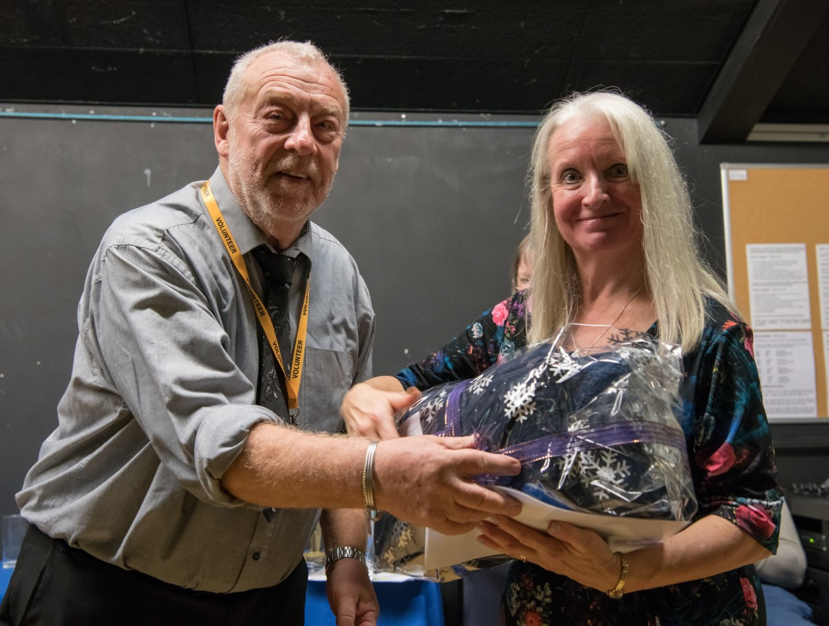 Paul Rutherford presents Vivienne Moles with her prize