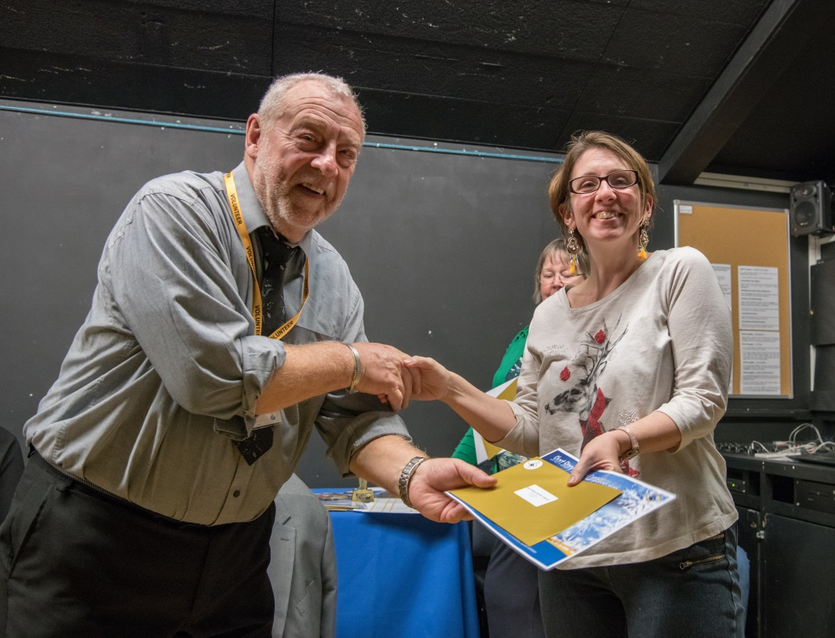 Paul Rutherford presents Vicky Kirby with her prize
