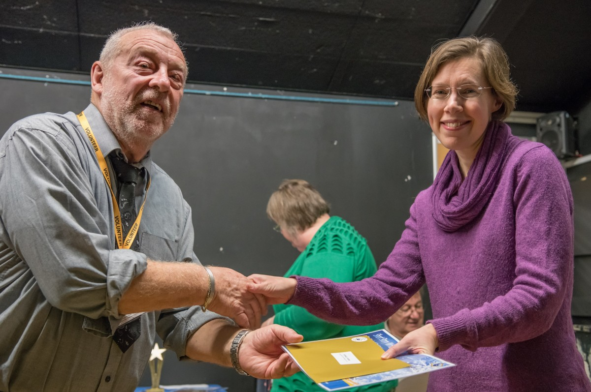 Paul Rutherford presents Alice Jones with her prize