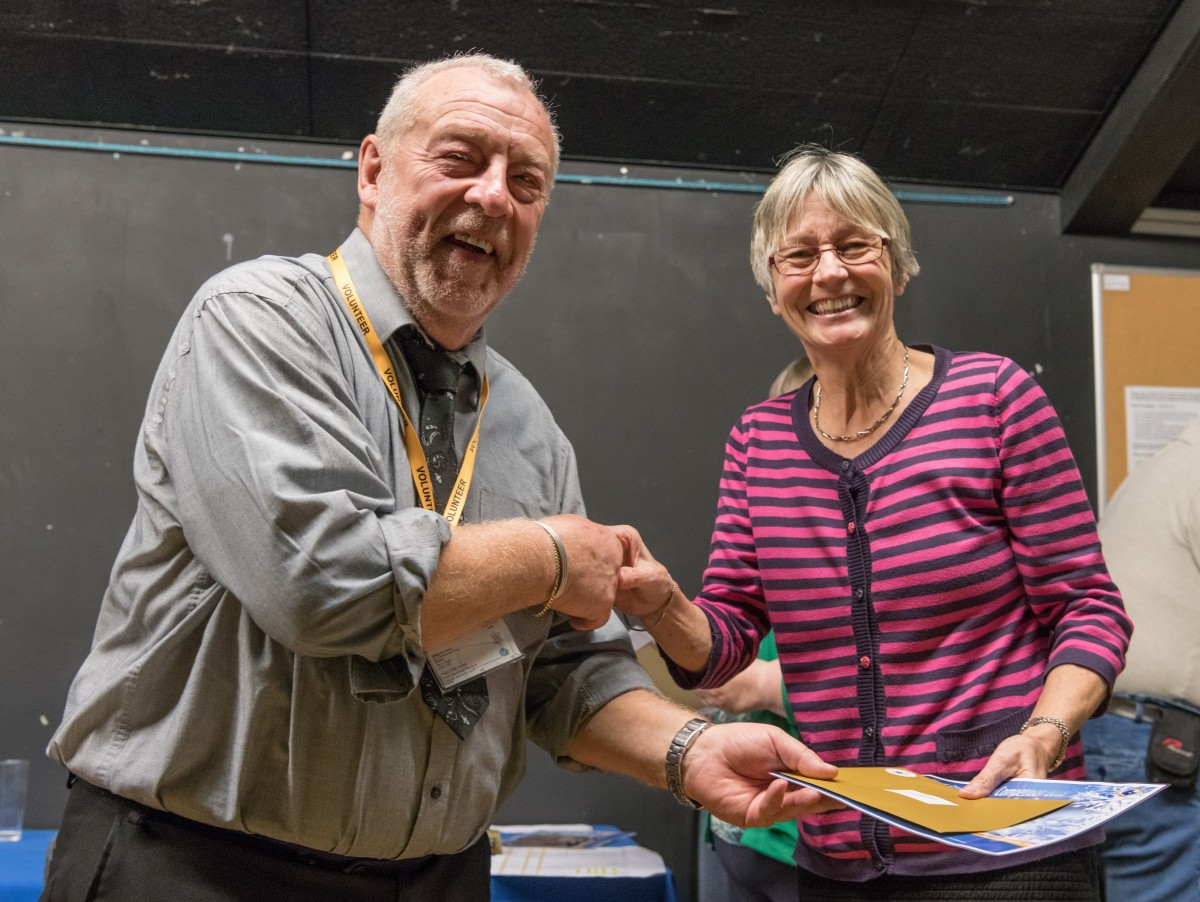 Paul Rutherford presents Eve Jackson with her prize
