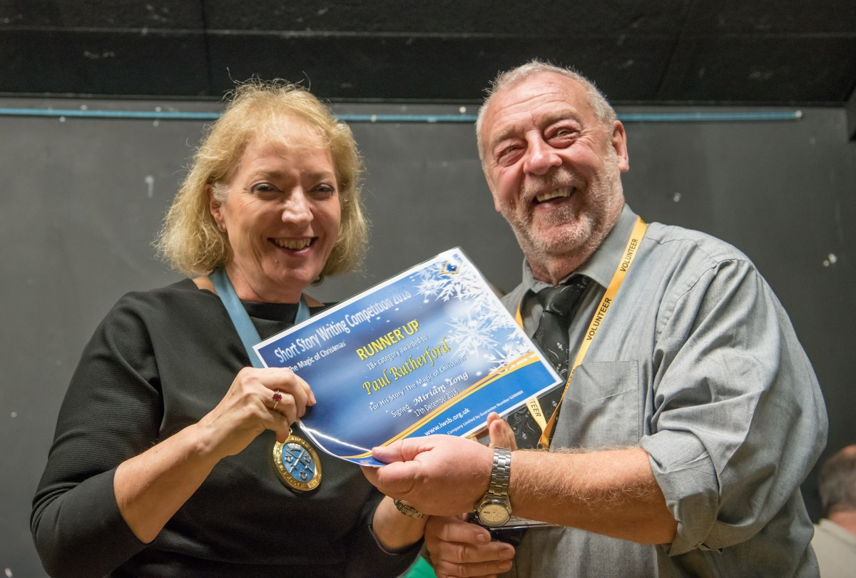 High Sheriff Gioia Minghella-Giddens presents Paul Rutherford with his prize