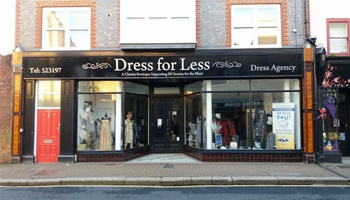 A picture of the Dress for Less store front.