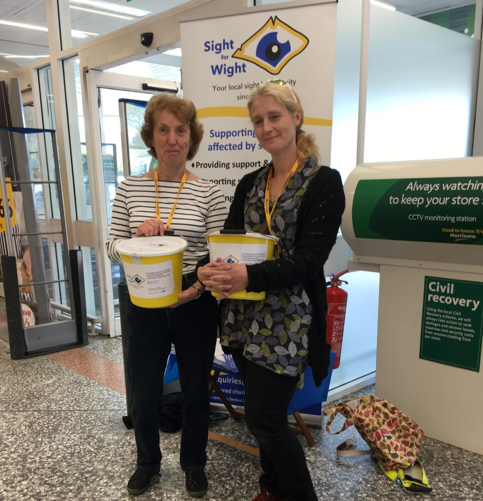 Pauline and Ruth standing with the collection buckets in Morrison's, Newport.