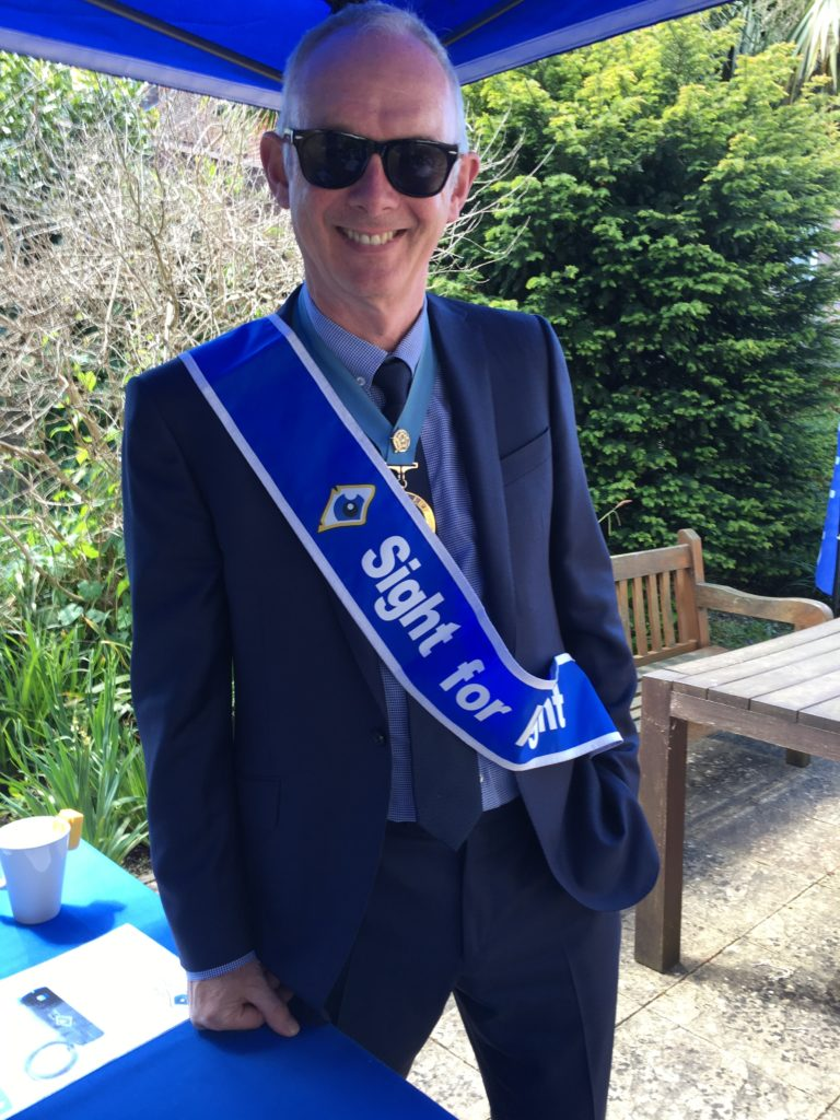 The High Sheriff donning our Sight for Wight sash
