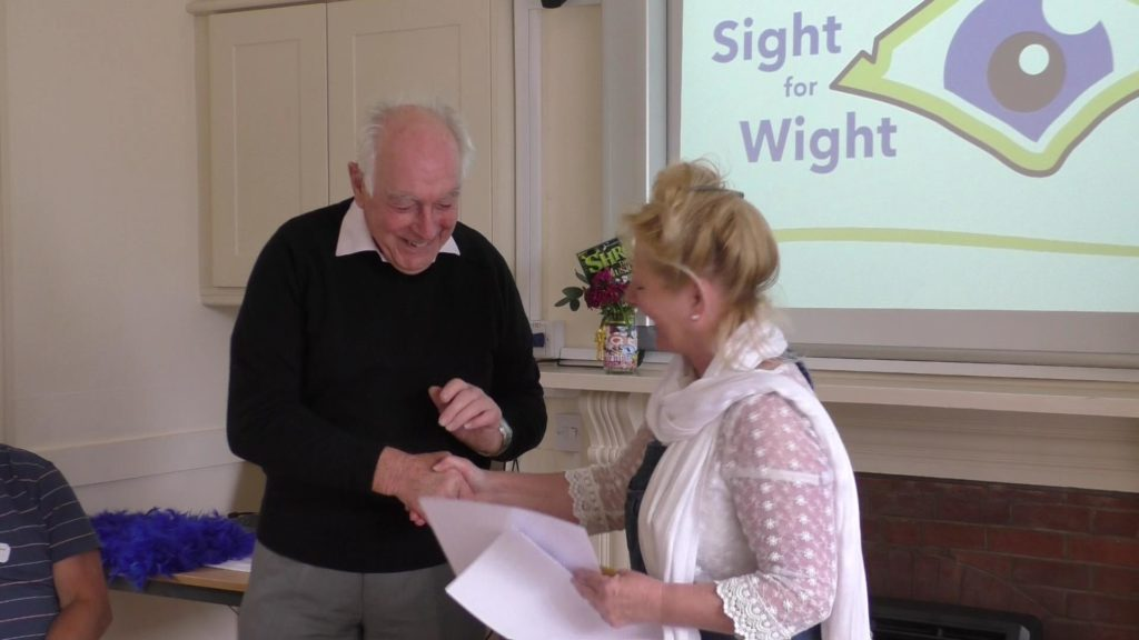 Terry (Volunteer) accepting his award from the CEO