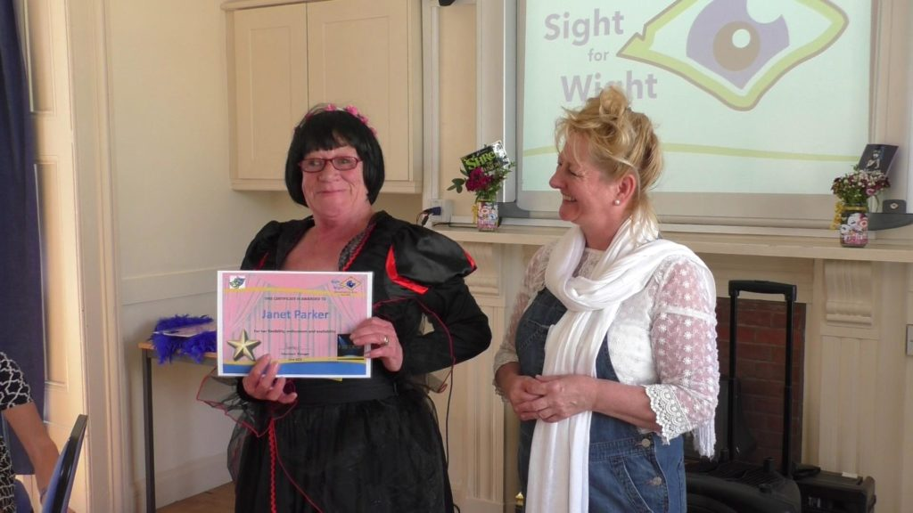 Janet (Volunteer) accepting her award from the CEO