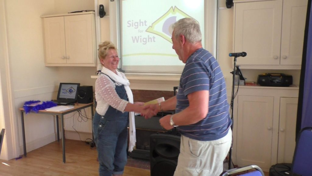 Paul (Volunteer & Trustee) accepting his award from the CEO