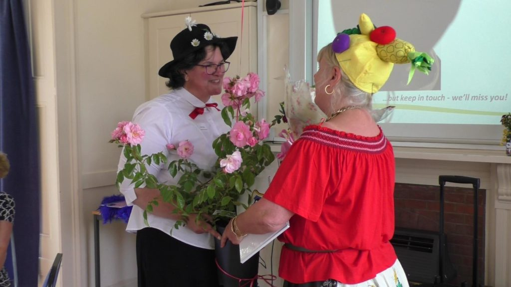 Susan presents Michelle with a beautiful rose as part of her retirement gift