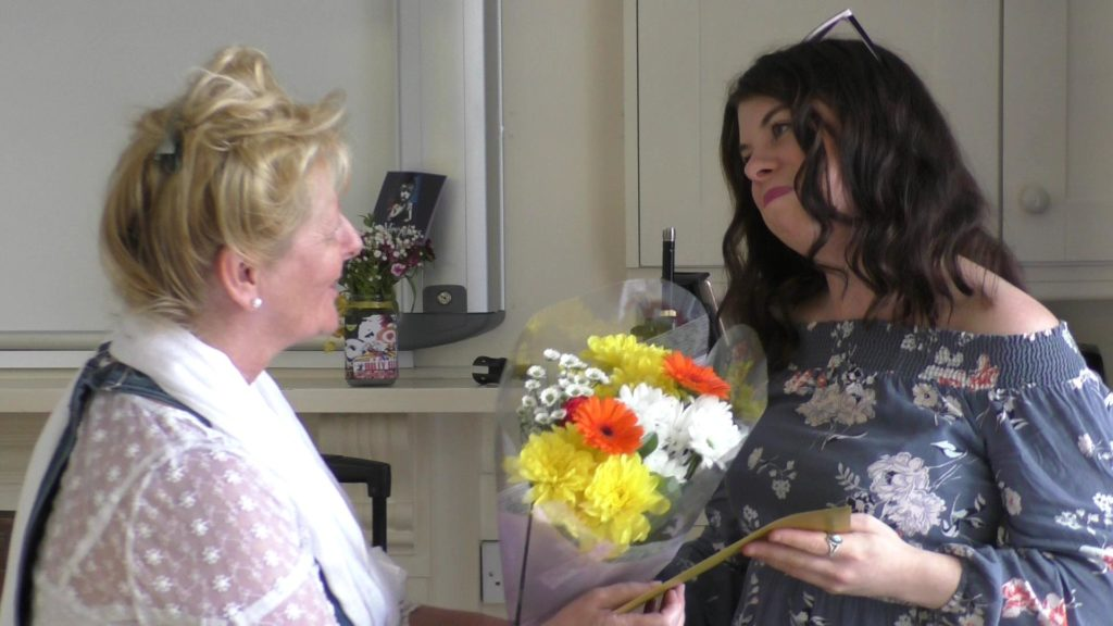 CEO presents Hannah with some flowers