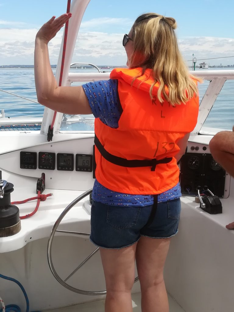 Member Services Manager, Laura, waving to passing boats!