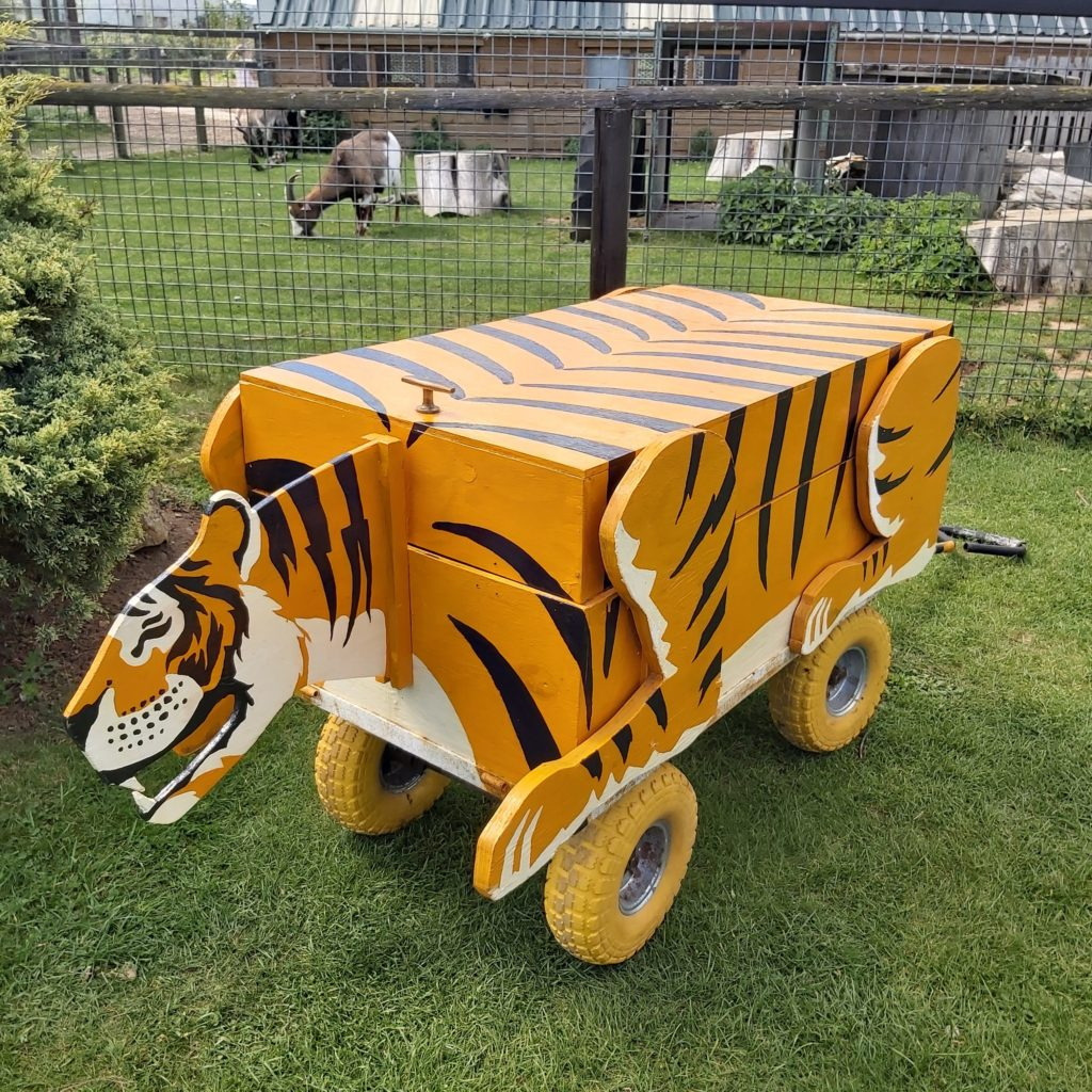 A box on wheels painted to look like a tiger.