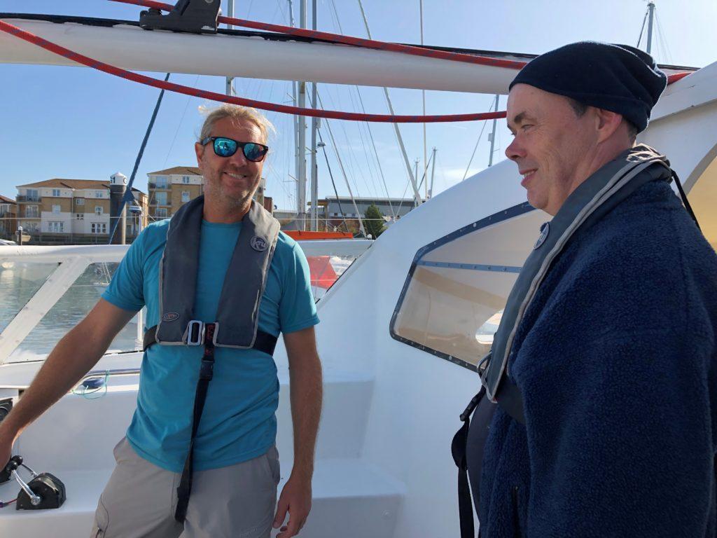 Skipper John (left) with member