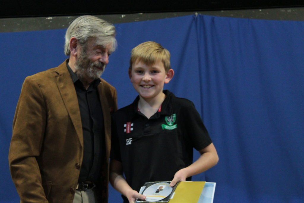 Melvyn Hayes presents the winning prizes to Ben Fry for his story, 'Christmas Joy' recorded by Melvyn Hayes.
