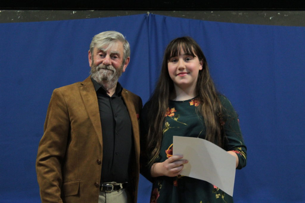 Melvyn Hayes presents the winning prizes to Ella Brear for her story, 'The Sound of Christmas' recorded by Kate Weston.