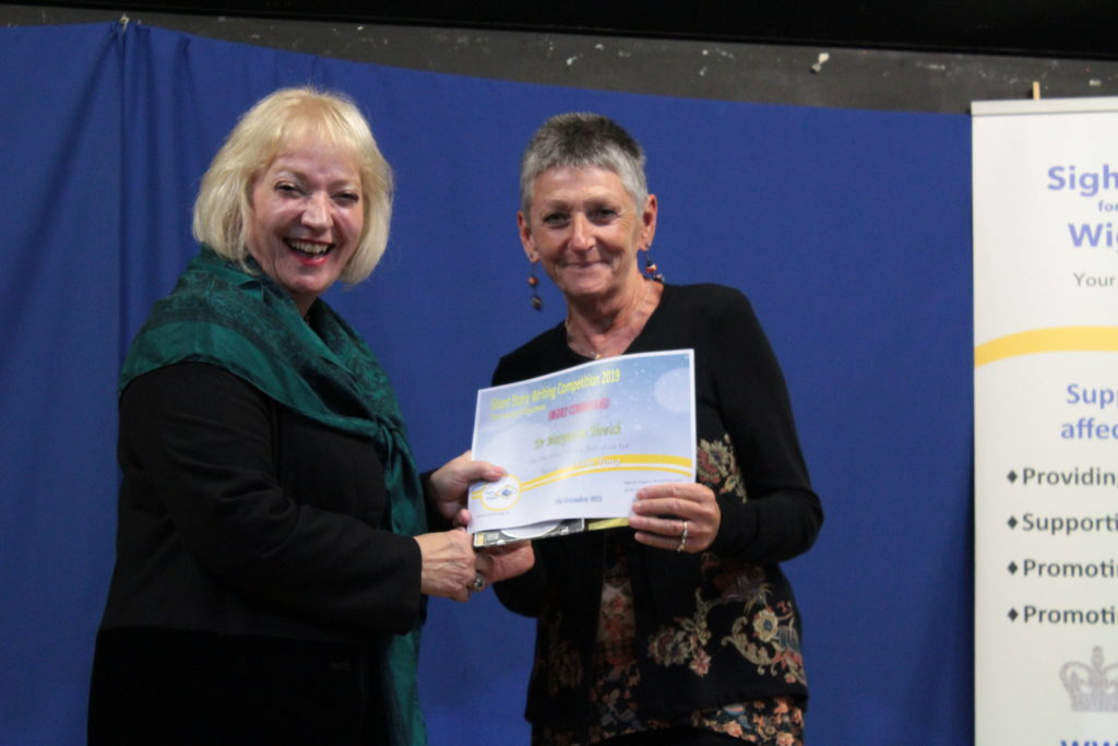 Gioia Minghella-Giddens presents the Highly Commended award to Dr Marguerite Howick for her story, 'In The Blink Of An Eye' recorded by Edana Minghella.