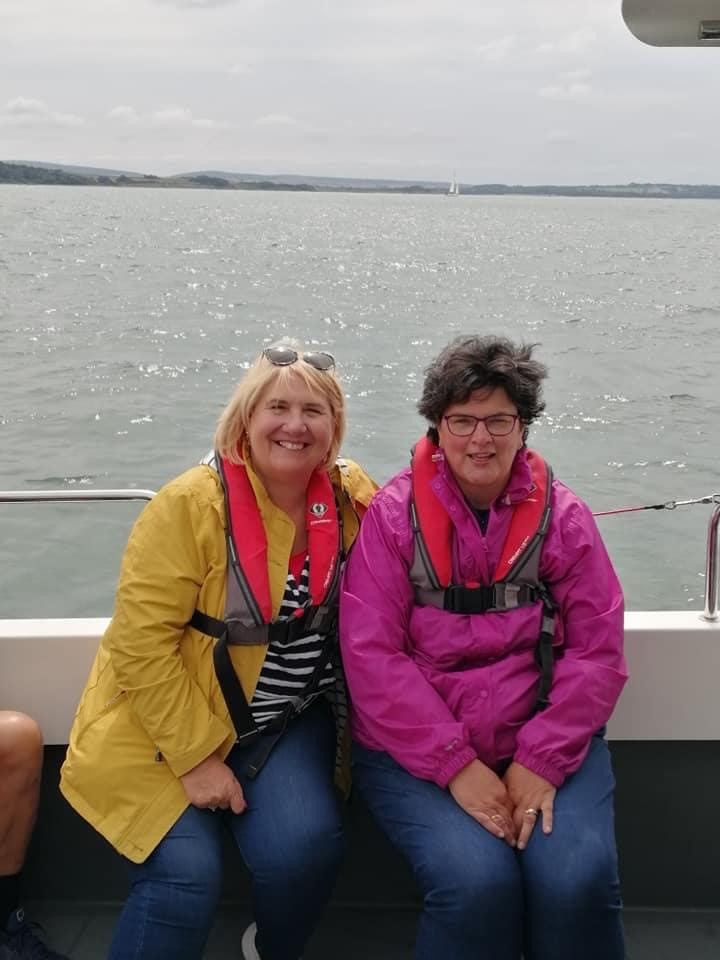 Sight for Wight Staff members, Susan and Elaine out on the ocean waves.